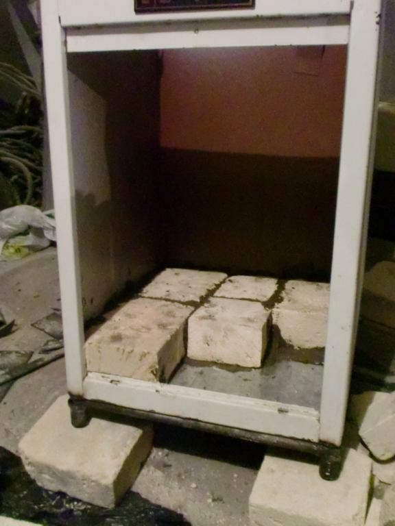 How to make a homemade electric pottery kiln. Lay the bottom of the kiln