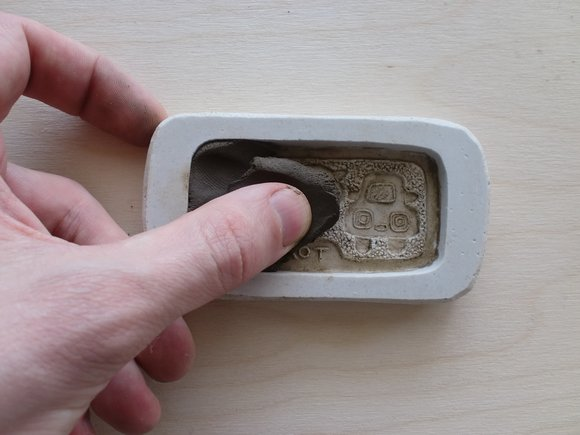 Fill the mould with clay