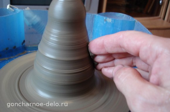 Pottery: trim the cone with your fingers